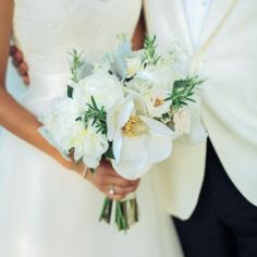 bride with simple magnolia bouquet